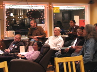 People intently watching the presidential debate at Grown Folks Coffee House, 10/15. Photo by Jason.