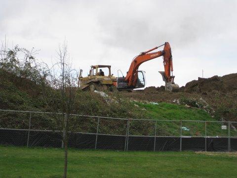 Removal of the earthen wall at Jefferson Park on Spokane Street. Photo by Joel Lee.