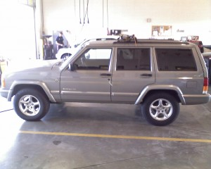Rob's 2001 Jeep Cherokee, driven through his garage door following a burglary on August 25th.